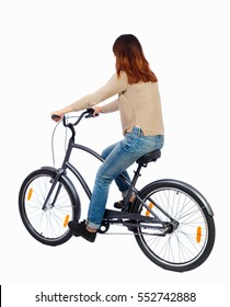 back view of a woman with a bicycle. cyclist sits on the bike. Rear view people collection.  backside view of person. Isolated over white background. Girl with long hair riding a bicycle.