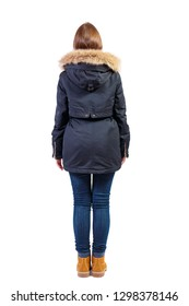 Back view woman in black winter jacket  looking up.  Standing young girl in parka. Rear view people collection.  backside view of person.  Isolated over white background.