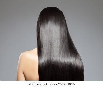 Back view of a woman with long straight hair