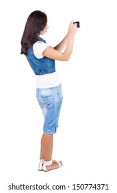 Back view of woman photographing.   girl photographer in shorts. Rear view people collection.  backside view of person.  Isolated over white background.