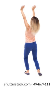 back view of woman pushes wall. Isolated over white background. Rear view people collection. backside view of person. The blonde in a pink t-shirt raised his hands up.