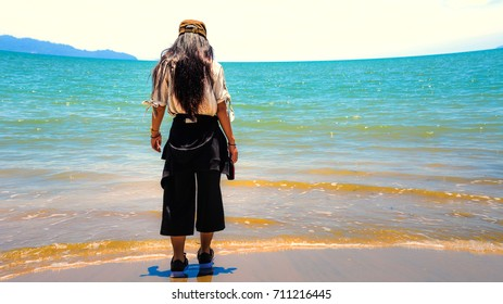 Back view of woman standing on the beach