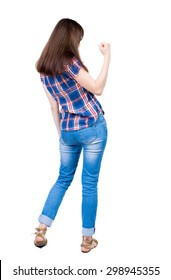 Back view of  woman thumbs up. Rear view people collection. backside view of person. Isolated over white background.  A young girl in a checkered blue with red stripes make right hand gesture success.