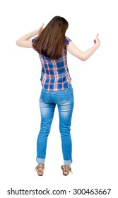 Back view of  woman thumbs up. Rear view people collection. backside view of person. Isolated over white background. A young girl in a checkered blue shirt shows two hands thumbs up.