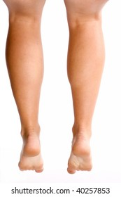 A back view of a woman's bare legs hanging.