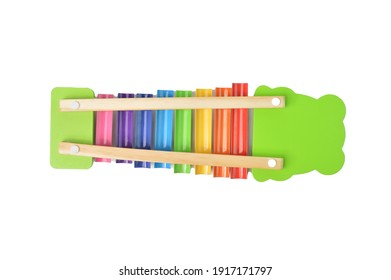Back view of wooden xylophone over white background