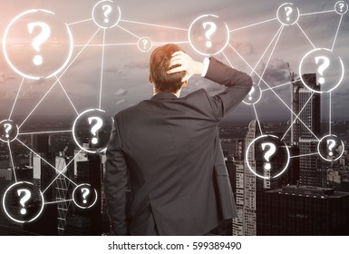 Back view of worried businessperson on city background with connected question marks. FAQ concept
