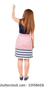 back view of writing beautiful redhead woman. Young girl in dress draws. Rear view people collection.  backside view of person. Isolated over white background.