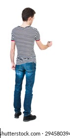 back view of writing man. Young man in jeans draws. Rear view people collection.  backside view of person. Isolated over white background. The guy in the striped shirt felt-tip pen draws ahead.