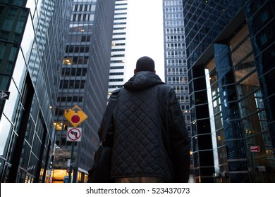 Back view of young African American professional in the city, photographed in NYC in November