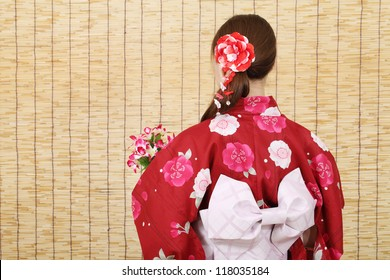 Back view of young asian woman in traditional clothes of kimono