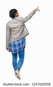 Back view of a young black girl in jeans and a checkered shirt. Rear view people collection. Isolated over white background. African American in autumn clothes conducts a tour.