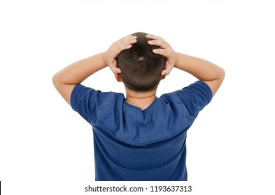Back view of young boy confusing. Shocked little boy with hands on head. Isolated on white background