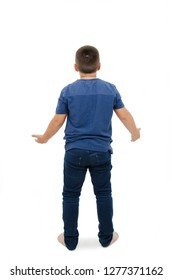 Back view of young boy confusing. Shocked little boy with hands up. Isolated on white background
