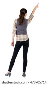 Back view of young brunette woman pointing  . beautiful girl in shirt gesture. Isolated over white background. Rear view.