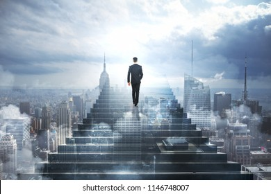 Back view of young businessman climbing abstract stairs on city sky background. Success and leadership concept. Double exposure