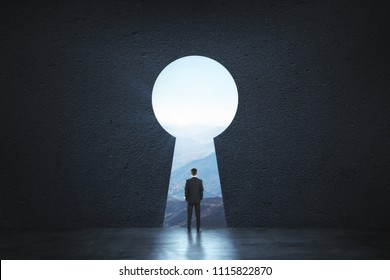 Back view of young businessman standing against keyhole door. Dream, success, opportunity and innovation concept