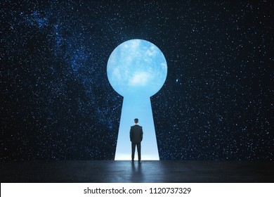 Back view of young businessman standing against keyhole door on starry sky background. Dream, success, opportunity and access concept
