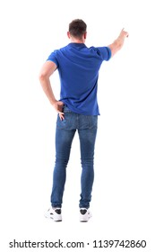 Back view of young casual adult man pointing finger showing way or pushing button. Full body isolated on white background.