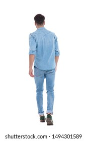 back view of young casual man wearing denim and walking, standing isolated on white background, full body, full length