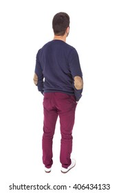 Back view of young casual man with the hands on the pockets, isolated on white background