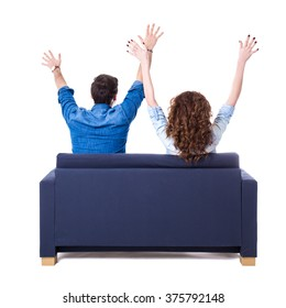 back view of young cheerful couple sitting on sofa isolated on white background