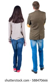 Back view of young couple man and woman hug and look into the distance. beautiful friendly girl and guy together. Rear view. Isolated over white background.
