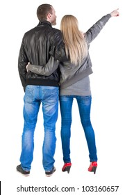 Back view of young couple pointing (woman and man). guy  and  girl  looking into the distance. Rear view people collection.  backside view of person.  Isolated over white background.