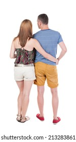 Back view of young embracing couple  beautiful friendly girl and guy together. Rear view people collection.  backside view of person.  Isolated over white background.