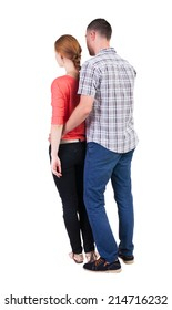 Back view young embracing couple (man and woman) hug and look into distance. friendly girl and guy together. Rear view people collection. backside view person. Isolated over white background.