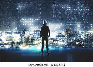 Back view of young hacker standing on abstract city circuit background. Hacking and phishing concept. Double exposure