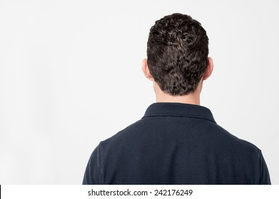 Back view of young man isolated over white