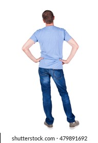 Back view of young man looking. guy his hands on belt. Rear view people collection.  backside view of person.  Isolated over white background.