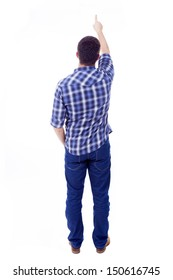 Back view of young man pointing up, isolated over white background