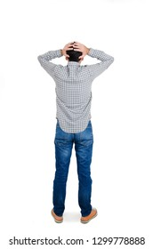 Back view of young man standing with hands on head. Isolated on white background