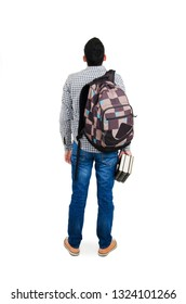 Back view of young student with backpacks and books, looking at wall. Isolated on white background