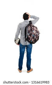 Back view of young student man standing with hand on head. Man with backpack and books. Isolated on white background