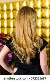Back view of a young woman with beautiful hair