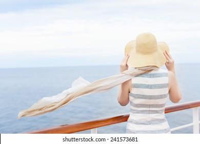 back view of young woman enjoying cruise