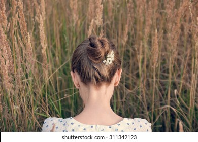 Back view of young woman with hair bun
