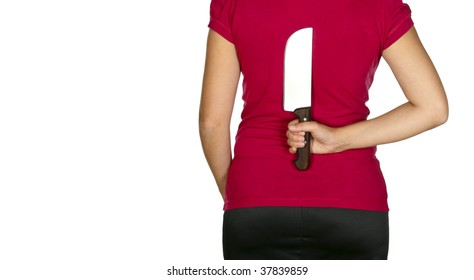 back view of young woman hide big knife behind her back isolated on white with space for text