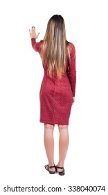 back view of young woman presses down on something. Isolated over white background. Rear view people collection. backside view of person.