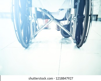 Back view of young woman in wheelchair in the hospital