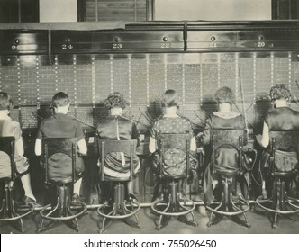 Back view of young women telephone switchboard operations. Washington, D.C., April 7, 1927.