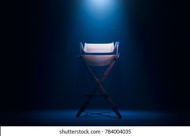 Back of a vintage director chair on a smokey background / high contrast image