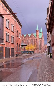 The back wall of the Aarhus Theater in 19th-century buildings of red brick and the medieval cathedral of Århus. Denmark
