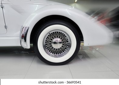 back wheel of an old car in a store