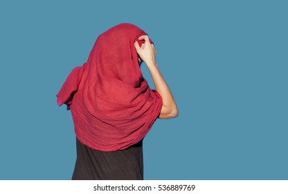 back woman with red veil. hijab