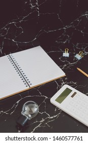 back to work concept: desk with mixed stationery items and notebook for future projects or tasks