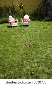 Back yard chairs and bocce ball game